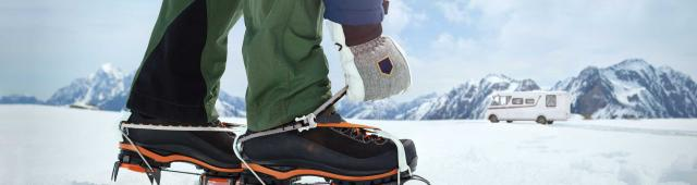 adjusting snow shoes on mountain
